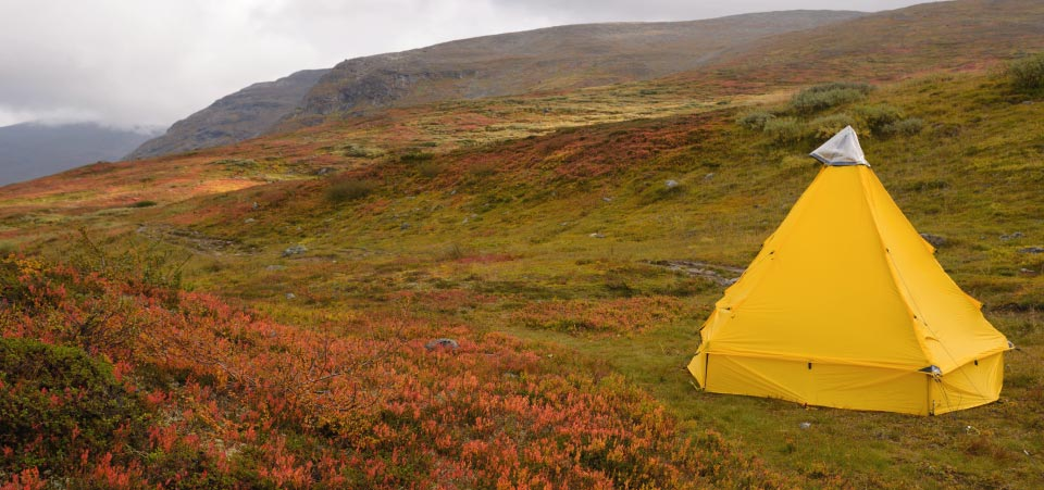Modular Shelter pitched on hillside, with sidewalls