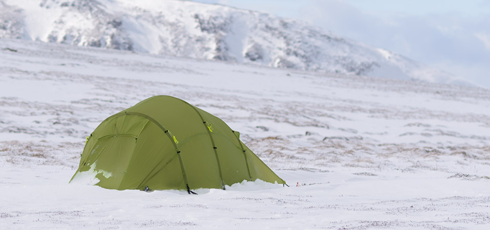 Quadratic Tent with snow ridge behind