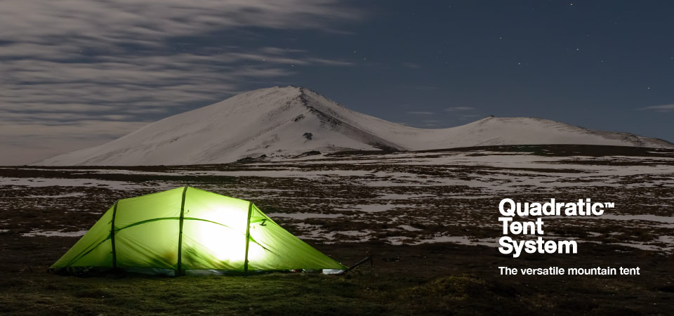 Quadratic Tent at night with snow covered hills and stars