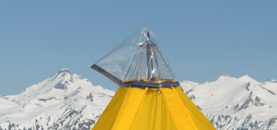 Rain Ceiling fitted to Modular Shelter, with mountains behind