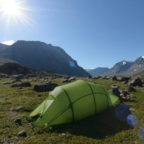 Quadratic tent pitched in the the mountains