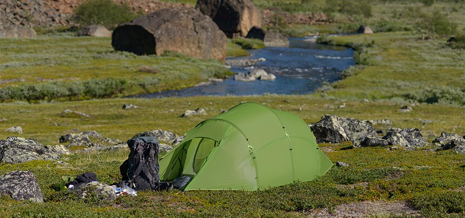 Quadratic Tent with backpack and river