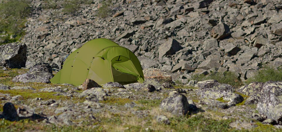 Quadratic Tent with rocks behind