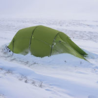 Quadratic tent pitched in wind-blown snow