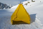 Modular shelter pitched on snow, with open sidewall.