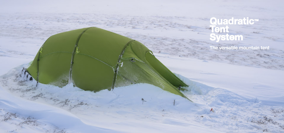 Quadratic Tent with drifted snow around sides